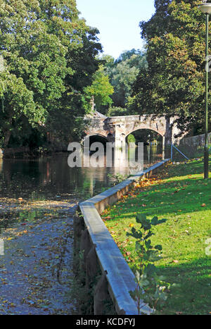 A view of the River Wensum with the historic Bishop Bridge in Norwich, Norfolk, England, United Kingdom. - Stock Photo