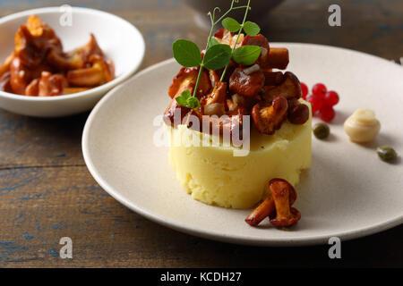 Tasty potato with mushrooms, food closeup - Stock Photo