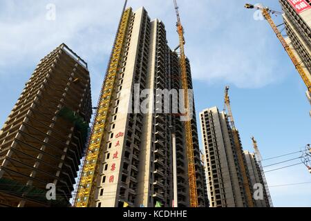 City of Taiyuan, Shanxi, China. New and under construction apartment blocks high rise accommodation, some are private - Stock Photo