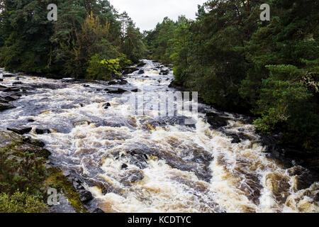 The Falls of Dochart run through the small town of Killin, in Loch Lomond & The Trossachs National Park, Scotland. - Stock Photo