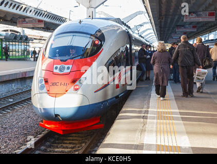 SAINT-PETERSBURG, RUSSIA - MAY 05, 2017: The Sapsan train is at the platform of the Moscow station. Passengers go - Stock Photo
