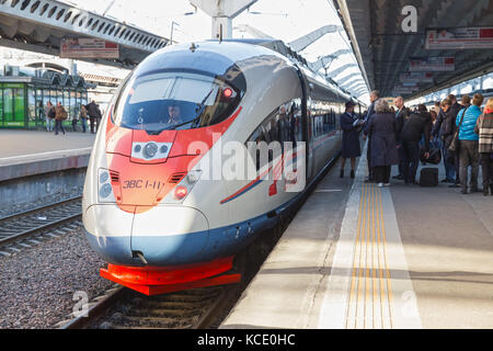 SAINT-PETERSBURG, RUSSIA - MAY 05, 2017: Passengers boarding the train Sapsan. The conductor checks the tickets, - Stock Photo