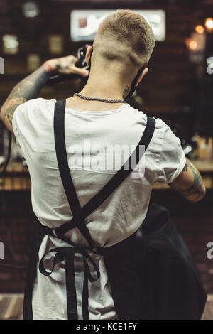 Anonymous barber in process of work - Stock Photo