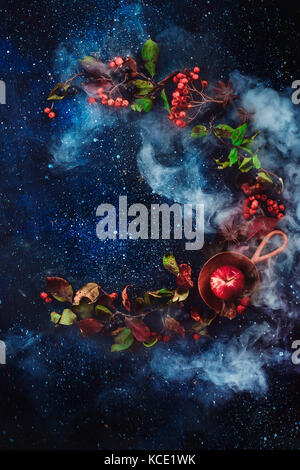 Autumn circle flat lay with apples and leaves on a dark starry sky background. - Stock Photo