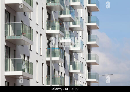 Exterior view of balconies of an apartment building as part of the Greenwich Peninsula Redevelopment, London, UK. - Stock Photo