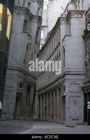 Angel Court, City of London, UK, reflecting the buildings opposite in the glass windows. Photographed on a cloudy - Stock Photo