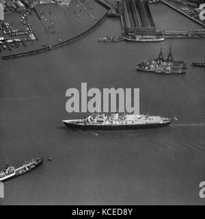 The Royal Yacht Britannia in Portsmouth Harbour. May 1959. Aerofilms Collection. - Stock Photo