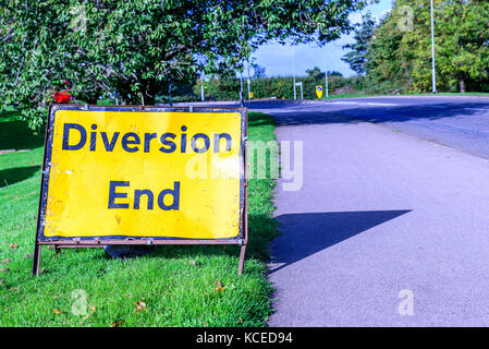 Diversion end sign on pedestrian footpath uk road - Stock Photo