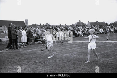 1960s, historical, young boys competing in an egg-and-spoon race at a schools' sports day, Dorchester, England, - Stock Photo