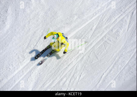 A skier carves a turn photographed from above. - Stock Photo