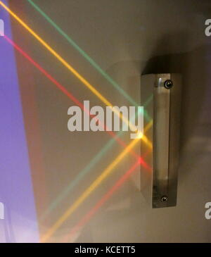 Three parallel beams of light are reflected off a mirrored surface: Reflection is the change in direction of a wave - Stock Photo
