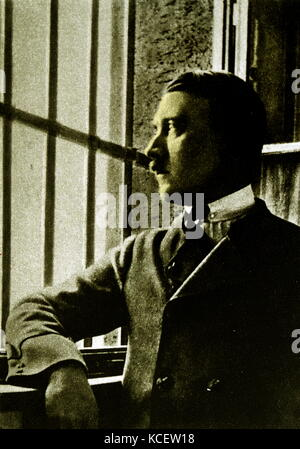 Adolf Hitler (1889-1945) looking out of the bars on the window to his prison cell at Landsberg Prison. In 1924 Adolf - Stock Photo