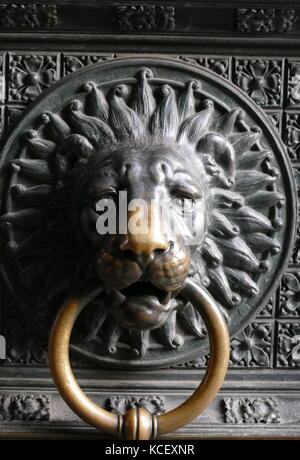 Photograph of the detail from the main doors of the Kölner Dom (The Cathedral of Saint Peter) a Roman Catholic cathedral - Stock Photo