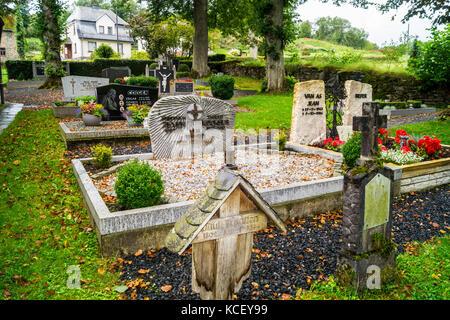 Graveyard of Chapel of St. Bartholomew,  876AD, Wiesenbach, St. Vith, Ostbelgien (Cantons de l'Est), Belgium - Stock Photo