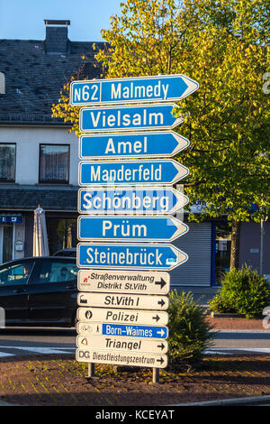Road sign indicating destinations in German, St. Vith, Ostbelgien (Cantons de l'Est), Belgium - Stock Photo