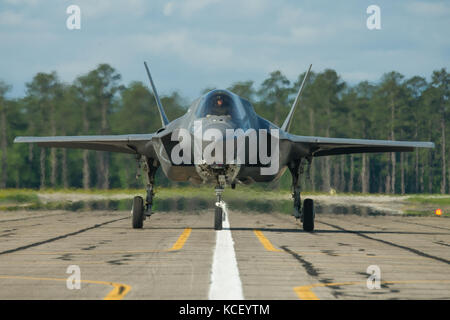 U.S. Marine Corps Maj. Brian Bann, a pilot assigned to VMFAT-501 at Marine Corps Air Station Beaufort, arrives in - Stock Photo