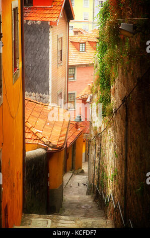 colorful yellow and orange painted houses in old town, Porto, Portugal, retro toned - Stock Photo