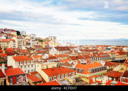 skyline of Lisbon over old town quarters with Se cathedral, Portugal, retro toned - Stock Photo