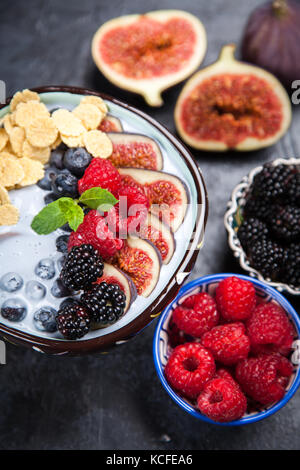 Delicious yoghurt bowl with berries and figs - Stock Photo