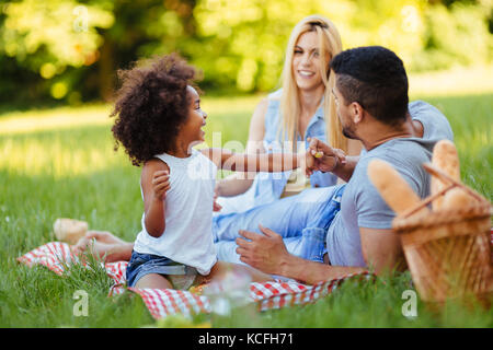 Happy family having fun time on picnic - Stock Photo