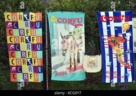 Some brightly coloured beach towels for sale in Kassiopi on the Greek island of Corfu. Gifts and souvenirs for drying - Stock Photo