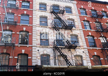 Typical old houses with facade stairs in TRibeca, NYC, USA - Stock Photo