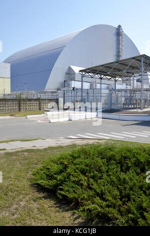The reactor 4 of the Chernobyl Power Plant, covered by the new sarcophagus, in Ukraine. - Stock Photo