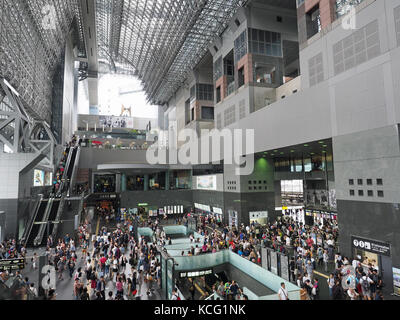 View during day time of the busy interior of Kyoto Station in Japan - Stock Photo