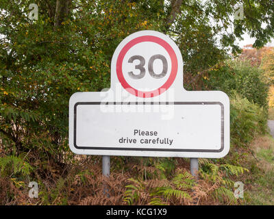village rectangle sign with 30 miles per hour speed limit; Essex; England; UK - Stock Photo