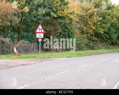road bend sign for half a mile post pole no cars transport; Essex; England; UK - Stock Photo