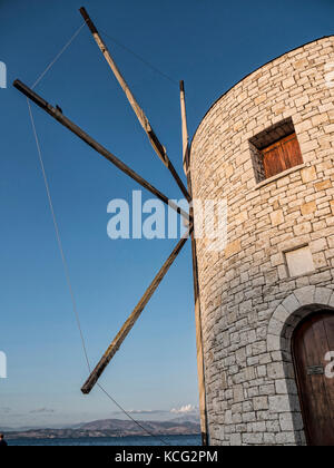 Windmill on Quayside in the Mon Repose Area of the Greek Island of Corfu - Stock Photo