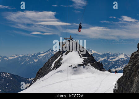 Punta Helbronner peak viewing point and the cable car station on the French-Italian border. Alps. - Stock Photo