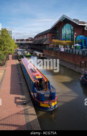 Canal boats moored on the Oxford Canal at Castle Quay Shopping Centre Banbury Oxfordshire England - Stock Photo