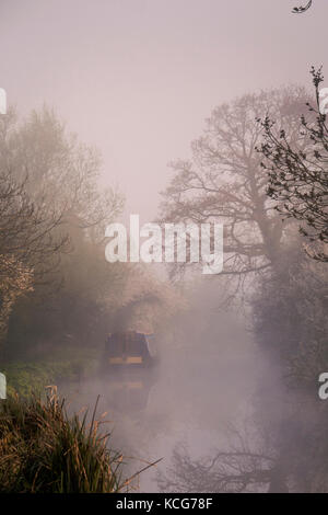 Canal boating Oxford Canal Oxfordshire England early morning mist - Stock Photo