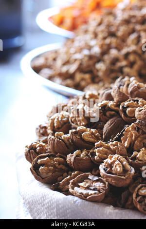 Chopped walnuts and dried fruits in bags at east bazar - Stock Photo