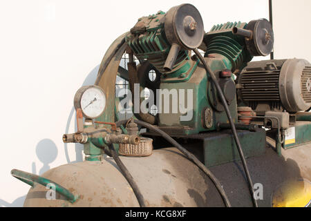 Gauge pressure on air compressor in pneumatic system - Stock Photo
