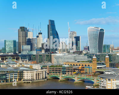 London skyline with a view of Southwark Bridge and skyscrapers of the north bank of the River Thames on a sunny - Stock Photo
