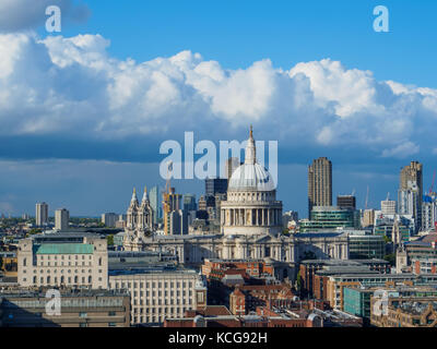 London skyline with a view of St Paul's Cathedral and skyscrapers of the north bank of the River Thames on a sunny - Stock Photo