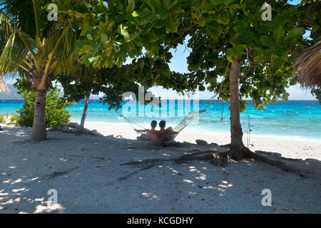 Philippines beach, Cebu island - couple relaxing in a hammock on honeymoon holiday, Cebu, Philippines, Asia - Stock Photo