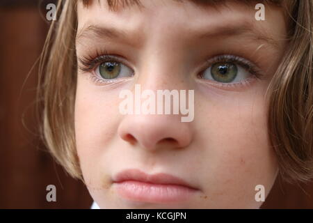 Close up portrait of a frustrated young girl - Stock Photo
