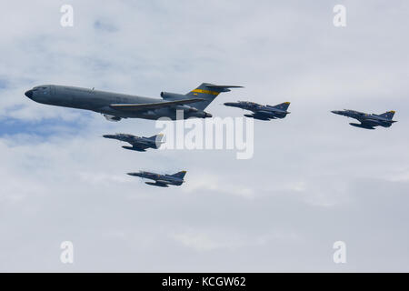 Colombian Air Force aircraft fly in formation over José María Córdova International Airport during Feria Aeronautica - Stock Photo