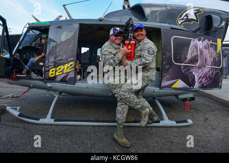 U.S. Air Force Master Sgt. Michael Glenn, left, and Master Sgt. Jeff Hopper, both crew chiefs assigned to the South - Stock Photo