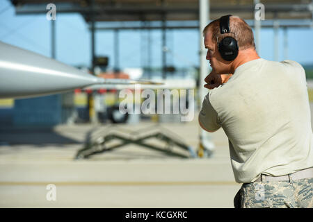 U.S. Air Force Staff Sgt. Eric Weishuhn, a crew chief with the South Carolina Air National Guard's 169th Aircraft - Stock Photo