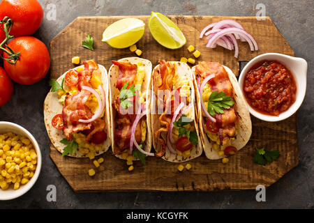Breakfast tacos with scrambled eggs and bacon - Stock Photo