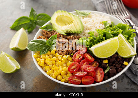 Mexican salad bowl with rice and pulled pork - Stock Photo