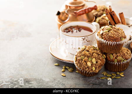 Healthy pumpkin muffins with tea and spices - Stock Photo
