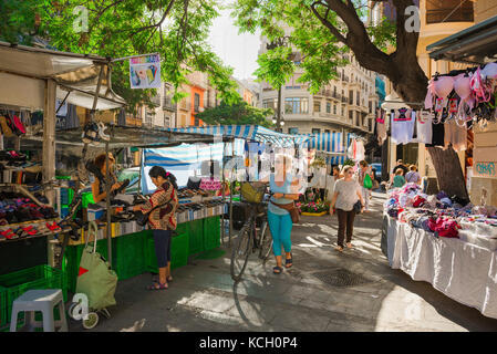 Valencia market Spain, people shop at stalls in the outdoor Sunday flea market held near the Mercado Central in - Stock Photo