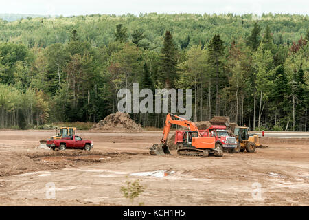 Clearcut forest deforest with machines trucks excavator in New Brunswick Canada - Stock Photo