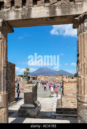 Ruins of the Roman Forum at Pompeii ( Pompei ) looking towards Mount Vesuvius in the background, Naples, Campania,Italy - Stock Photo
