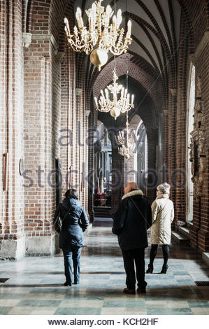POZNAN, POLAND - JANUARY 23, 2017: Unidentified people walking in a hall of the Archcathedral Basilica of St. Peter - Stock Photo